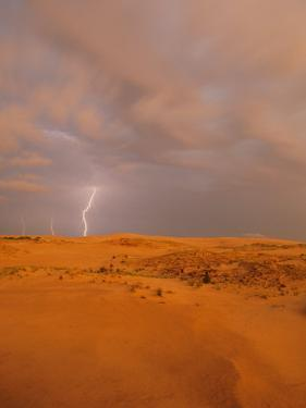 A Bolt of Lightning Strikes the Sand Dune Landscape by Skip Brown