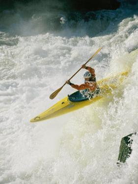 A Kayaker Takes the Plunge Through the Raging Whitewater on the Potomac River by Skip Brown