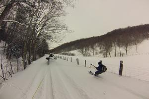 A Skier Towed by an All Terrain Vehicle Equipped with Tracks for Backcountry Access by Skip Brown