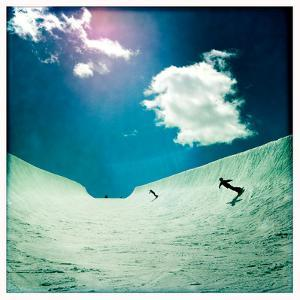 An Eleven Year Old Boy and His Mom Snowboarding in a Large Half-Pipe by Skip Brown