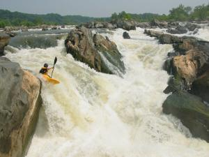 Kayaker Paddles off Grace Under Pressure, Top Drop of Great Falls by Skip Brown