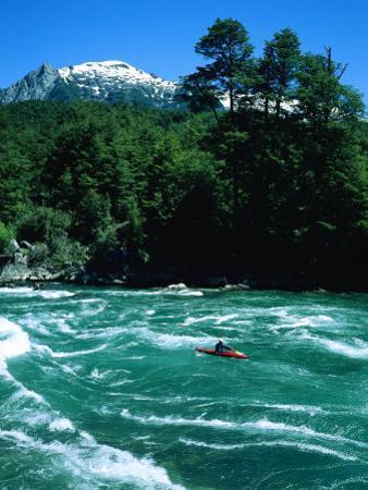 Kayaker Surfing Terminator Rapid Waves, Futaleufu, Chile by Skip Brown