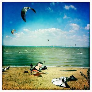 Kite Boarders and Windsurfers Sail Near the Chesapeake Bay Bridge by Skip Brown