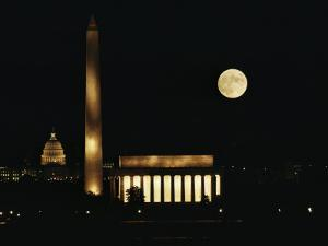 Lincoln Memorial, Washington Monument, Capitol and a Full Rising Moon by Skip Brown
