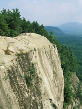 Mountain Biker on Edge of Cliff, Cathedral Rock, North Conway by Skip Brown