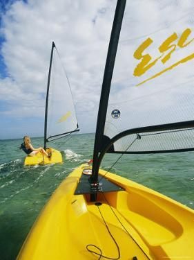 Small Cat-Rigged Boat Sailing off the Florida Keys by Skip Brown