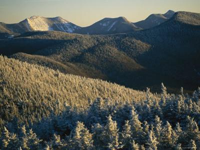 Snow Covers Trees and Hills in the Adirondack Mountain Region by Skip Brown