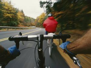 View over the Handlebars of a Bicycle Speeding along a Vermont Road by Skip Brown
