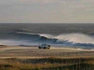 Wind, Waves and Fisherman in an Suv on a Beach in the Outer Banks by Skip Brown