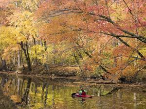 Woman Kayaking Down the Chesapeake and Ohio Canal National Park by Skip Brown