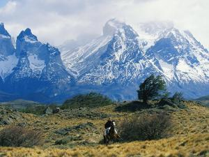 Woman Riding Horseback, Torres Del Paine National Park by Skip Brown