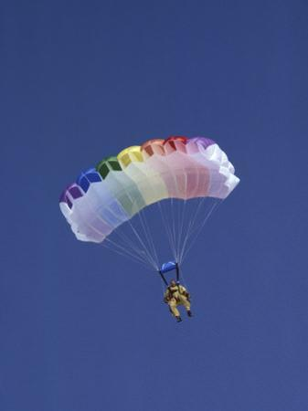 Skydiver with Rainbow Hued Parachute