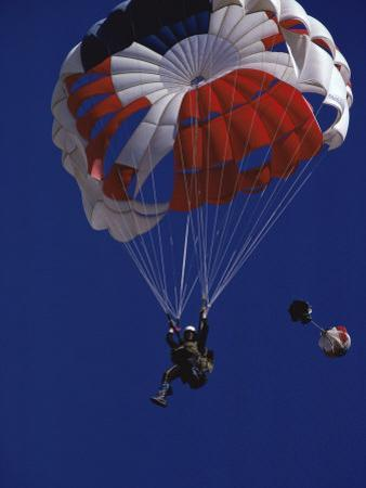 Skydiver with Red, White and Blue Parachute