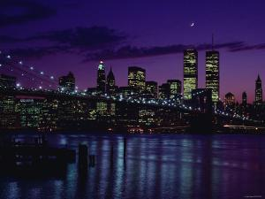 Skyline of New York City with Illuminated Lights Off Buildings and High-Rises at Night