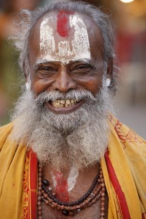 https://imgc.allpostersimages.com/img/posters/smiling-sadhu-with-vishnu-mark-on-his-forehead-rishikesh-uttarakhand-india_u-L-Q1GYJEC0.jpg?artPerspective=n