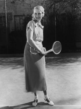 Smiling Woman Playing Tennis