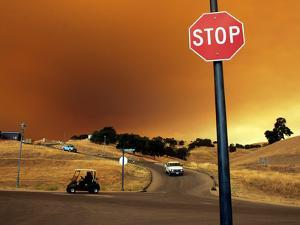 Smoke from a Wildfire Billows Over a Hillside