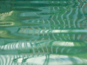 Smooth Green Water Rippling in a Pool
