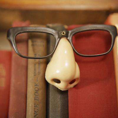 Joke Glasses and Nose in Bookshelf