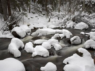 https://imgc.allpostersimages.com/img/posters/snow-covered-boulders-and-flowing-creek-glacier-creek-rocky-mountain-national-park-colorado-usa_u-L-P7NF7K0.jpg?p=0