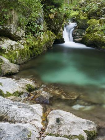 https://imgc.allpostersimages.com/img/posters/soca-small-waterfall-close-the-source-triglav-national-park-julian-alps-slovenia_u-L-Q1EY2TA0.jpg?artPerspective=n