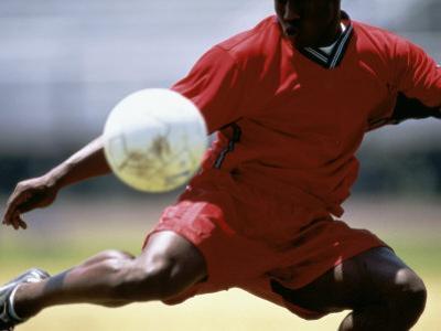 Soccer Player Preparing to Kick Ball
