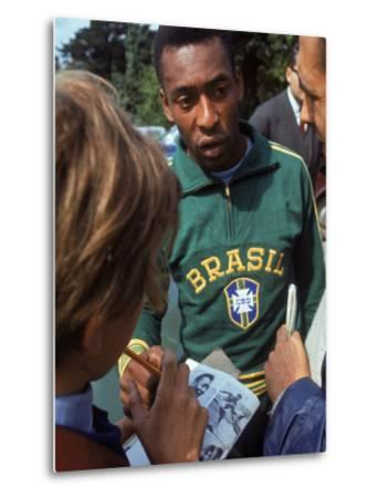 Soccer Star Pele Signing Autographs for Fans During a Practice Prior to World Cup Competition