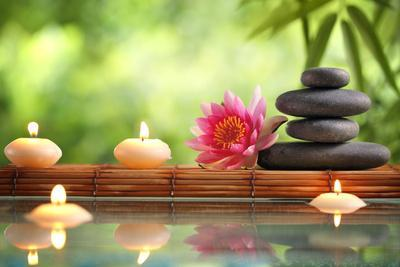 Spa Still Life with Burning Candles,Zen Stone and Bamboo Mat Reflected in a Serenity Pool