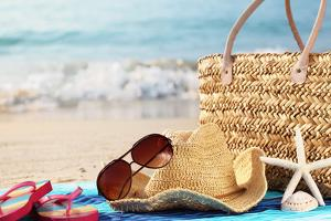 Summer Beach Bag with Straw Hat,Towel,Sunglasses and Flip Flops on Sandy Beach by Sofiaworld