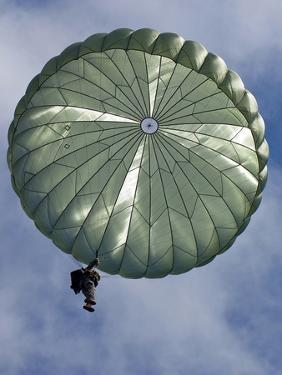 Soldier of the 82nd Airborne Descends from a Parachute Drop Over, 2010