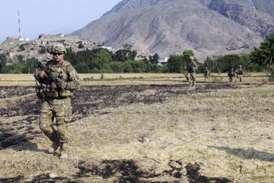 Soldiers Conduct a Dismounted Patrol in Afghanistan
