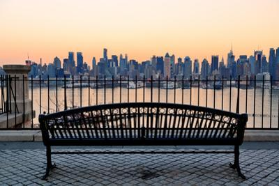 Bench in Park and New York City Midtown Manhattan at Sunset with Skyline Panorama View