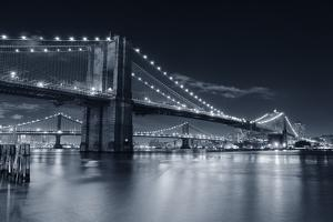 Brooklyn Bridge Over East River At Night In Black And White In New York City Manhattan by Songquan Deng