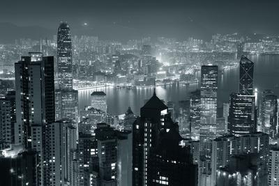 Hong Kong City Skyline At Night With Victoria Harbor And Skyscrapers Illuminated
