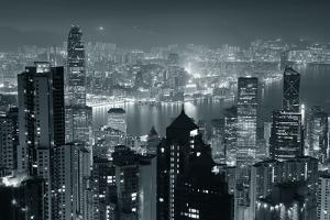 Hong Kong City Skyline At Night With Victoria Harbor And Skyscrapers Illuminated by Songquan Deng