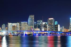 Miami City Skyline Panorama at Dusk with Urban Skyscrapers and Bridge over Sea with Reflection by Songquan Deng