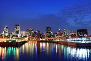 Montreal over River at Dusk with City Lights and Urban Buildings by Songquan Deng