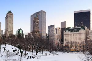 New York City Manhattan Central Park Panorama in Winter with Snow, Freezing Lake and Skyscrapers At by Songquan Deng