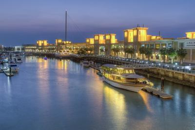 https://imgc.allpostersimages.com/img/posters/souk-shark-mall-and-kuwait-harbour-illuminated-at-dusk-kuwait-city-kuwait-middle-east_u-L-PQ8NRB0.jpg?p=0