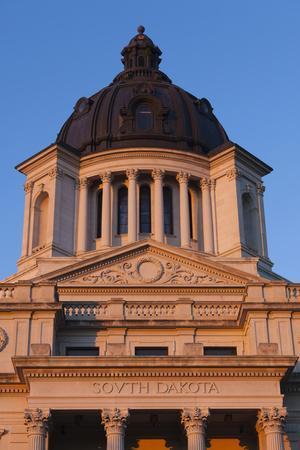 https://imgc.allpostersimages.com/img/posters/south-dakota-state-capitol-exterior-sunset-pierre-south-dakota-usa_u-L-PN6XU90.jpg?p=0