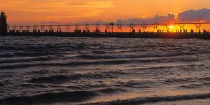 South Haven Lighthouse and pier at sunset, South Haven, Michigan, USA