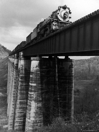 https://imgc.allpostersimages.com/img/posters/southern-railway-train-on-trestle-bridge-210-foot-tressel-over-the-north-broad-river-georgia_u-L-P3P8VY0.jpg?p=0