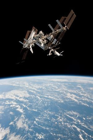 https://imgc.allpostersimages.com/img/posters/space-shuttle-endeavor-docked-at-international-space-station-2_u-L-PMT1R90.jpg?artPerspective=n