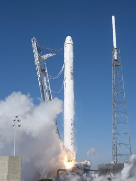 Spacex'S Falcon 9 Rocket and Dragon Spacecraft Lift Off from Cape Canaveral Air Force Station