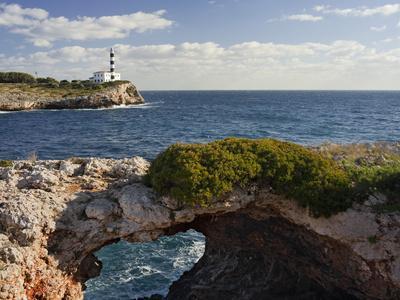 https://imgc.allpostersimages.com/img/posters/spain-majorca-east-coast-lighthouse-of-portocolom-punta-de-s-homonet_u-L-Q11YLWN0.jpg?artPerspective=n