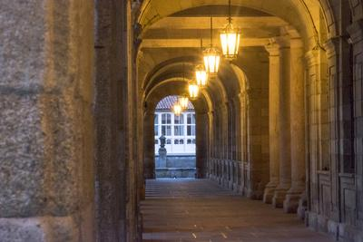 https://imgc.allpostersimages.com/img/posters/spain-santiago-archways-and-door-near-the-main-square-of-cathedral-santiago-de-compostela_u-L-Q12TB870.jpg?p=0