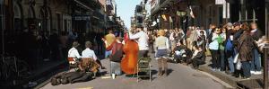 Spectator Looking at Street Musician Performing, Bourbon Street, New Orleans, Louisiana, USA