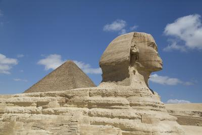 https://imgc.allpostersimages.com/img/posters/sphinx-in-foreground-and-the-great-pyramid-of-cheops-the-giza-pyramids_u-L-PWFSE00.jpg?p=0