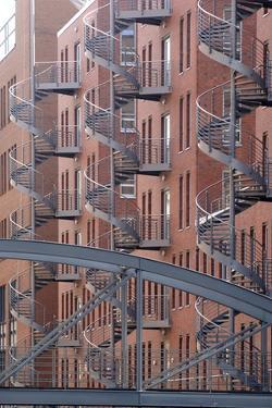 Spiral Staircases on Facades of Some Former Warehouses Destined for Repurposing
