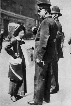 A Suffragette Confronting Two Policemen, 1913 by Sport & General